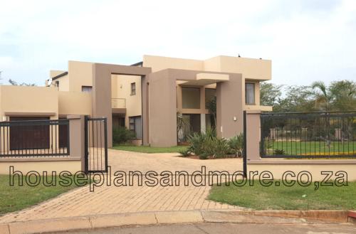 Double storey concrete flat roof house plan design for client